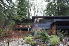 """Kevin and Audrey's home is on an oversized, forested lot in a quiet community north of Seattle. The McGills' proudest DIY:  """"Our front exterior transformation.  We built the upper and lower decks, fence, courtyard, painted our exterior, and removed the previous grass and replaced it with our own landscaping."""""""