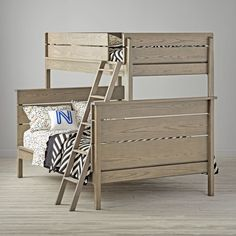 Our Wrightwood Twin-Over-Full Bunk Bed has made it easier than ever to create the right look right away for any room in your home. The stunning Stained Grey finish allows the wood's natural grain to show through and makes the bed easy to coordinate with your other furniture and decor. And its slatted headboard and rounded edges give it a smooth, refined look.