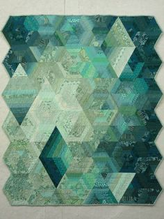 Reflections -- Linda Nussbaum. This monocrhomatic quilt demonstrates the importance of using contrasts in value (light/dark.)