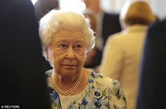 The Queen looked unimpressed as she met David Cameron and other politicians to celebrate h...