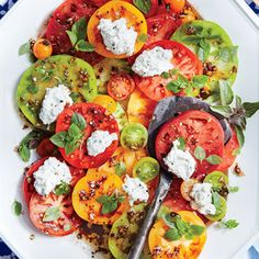 Sliced heirloom tomatoes are wow-worthy on their own--a simple vinaigrette and dollops of basil-flecked ricotta take them over the top. Serve with toasted baguette slices to sop up any tomato juices.
