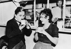 """Charlie Chaplin & Paulette Goddard take a break, during production of """"The Great Dictator""""."""