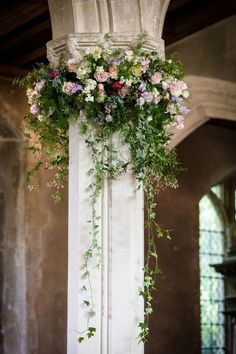 Ignore the colours but garlands for the pillars made up of your colours in blues, whites, ivories, yellows & peaches. With trailing foliage. #churchwedding Church Wedding Flowers, Church Wedding Decorations, Church Weddings, Aisle Decorations, Wedding Pillars, Wedding Ceremony, Church Flower Arrangements, Floral Arrangements, Church Aisle