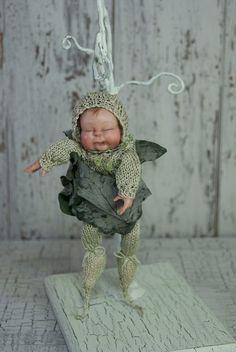 Ooak Fairy baby in  snuggle pod  Faerie art doll via Etsy.  Artist Leigh Jordan, so talented.