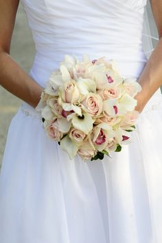 Ivory wedding bouquet with light pink accents