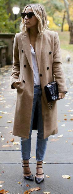 Strappy heels + long tan coat.