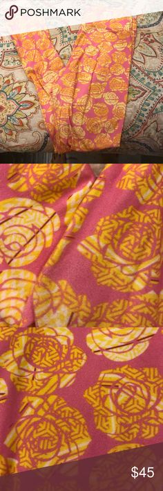 Lularoe Disney yellow 🌹! Pink leggings with yellow Aztec pattern yellow roses. Worn around the house one time. Washed according to lularoe instructions. Accepting offers on all of my products! LuLaRoe Pants Leggings