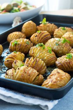 Crispy & classy potatoes smothered in garlic, parmesan & herbs.