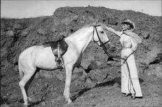 Vintage photo of Ursula Andress with horse.