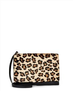 Everybody – repeat, everybody – should have a touch of leopard print in their wardrobes. And, if head-to-toe isn't really your thing, get your fix with accessories. In rich Italian leather, this cros