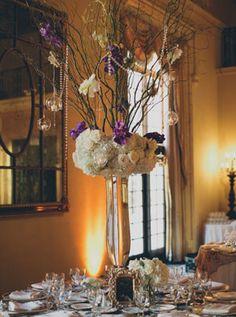 Purple and white tall glass centerpiece wedding decor; Photo: Kat Braman Photography