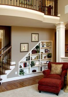 I like these shelves hidden in the framework of the stairs.