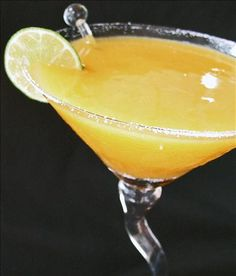 Mango Margarita -- ½ lime in quarters   ½ cup tequila, 1 ounce triple sec/ Cointreau/Grand Marnier, 2⁄3 cup mango nectar (in Hispanic aisle/stores), ¾ cup partially frozen mango (prefer individual quick frozen or fresh) (optional), 2 ounces simple syrup or 2 ounces sour mix,    3 tablespoons lime juice, 1 cup ice cubes, lime slices for garnish...Blend together and enjoy!