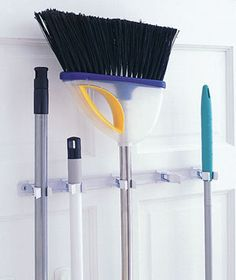Mount mop and broom holders on the back of the closet door. (Try the Crawford Spring Grip; $4, acehardware.com.) They'll be out of the way and can air-dry. Even better, for ventilation, insert a screen panel on the lower half of the door.