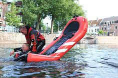 rescue tip-board by spark design is an inflatable tilting life-raft