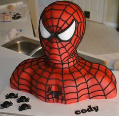 "Spiderman bust cake.  Awesome cake...sorry about the ""unseemly"" nature of some of the blogger's comments!"