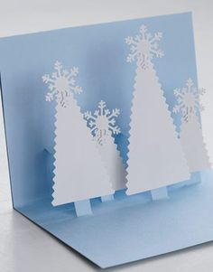 Easy Holiday Snowflake Crafts...A pop-up card is always cause for smiles, especially when it's as pretty as this snowy woodland scene. It's very easy to make, too, with two colors of card stock, scissors, a paper punch, and, of course, a glue gun or paper glue...Slides 14-16