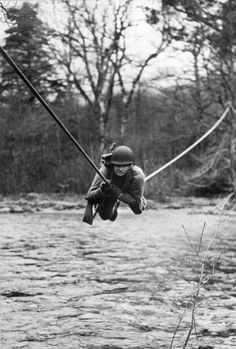 4th March 1943: An American Commando crossing a river by a single rope as part of a battle course designed and run by the British army in the highlands of Scotland. A number of U.S. army personnel have taken the course before returning to their units as instructors. (Photo by Reg Speller/Fox Photos/Getty Images)