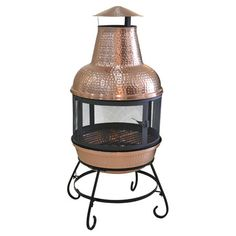 Add a warm touch to your patio or poolside seating group with this lovely chiminea, showcasing a copper base and spark guard screen.