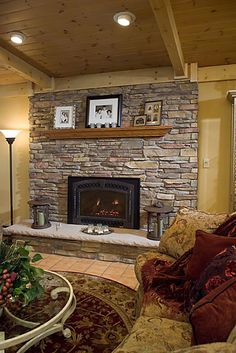 stacked stone fireplace but with a dark cherry wood mantle diy