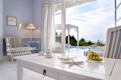 Holiday villa rental in Sporades. Luxury sea view villa with private pool in Alonnisos. Anemolia Βlue welcomes you with:a sitting room le. Villa With Private Pool, Greece, Interiors, Sea, Mirror, Luxury, Holiday, Room, Furniture