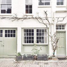 white brick exterior with spring green accents, olive gray shadows, cobblestone, sherwin williams acier Exterior Colors, Exterior Paint, Exterior Design, Interior And Exterior, Loft, Outdoor Living, Outdoor Decor, Facades, House Painting
