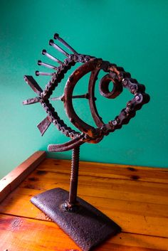 Awsome fish made with old fashioned cut nails and chain link. Great gift for the fisherman, outdoors enthusiast, or displayed in the bar / man cave.