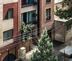 boozhgan architecture studio sculpts a dynamic brick facade for the haghighi house | architectth.com