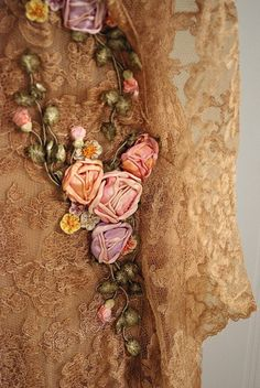 Detail of an Edwardian dress with Chantilly lace and ribbon embroidery.