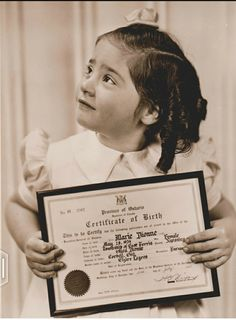 Marie with birth certificate