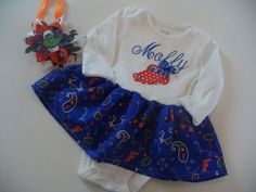 This is a onesie for a baby girl with embroidered Gator head and Gator fabric skirt attached. The options on this onesie is a personalized name