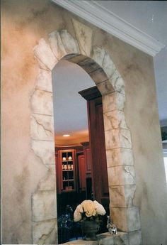 Glazing done around walls with a broken stone arch to frame it in. This is wrapping the archway. Regann Hunt-Royster