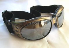 These are brand new, distressed, faux antique gold/brass-look steampunk goggles.  They have impact resistant, non-breakable lenses.  Perfect for fashion, clubbing, Burning Man, motorcycle or sporting wear, or just plain kickin it.  ATTN BURNERS:  This is for those of you who are shopping for goggles and like a style that has vents in the frames, but youre concerned about wearing them and taking the chance of dust particles, sand, and debris getting in.  Air vents, or small pin holes in the…