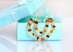 Baltic Amber Teething Necklace, Baltic Amber Jewelry, Free Stories For Kids, Natural Pain Relief, Jewelry Necklaces, Jewellery, Blue Gift, Unisex Baby, Drop Earrings
