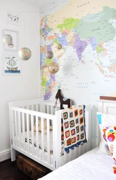 Why use the usual wallpaper? This map has all the sweetness that matches the playful baby room -- world map wall paper from The Wall Sticker Company (or use real maps) & globe mobile from ABC Kitchen in NYC -- apartment therapy