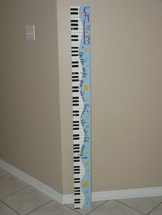custom wooden growth chart for a girl or boy`s room.  Musical theme. Can be made custom by Signs By Design. Email info@signsbydesign.ca for more info.