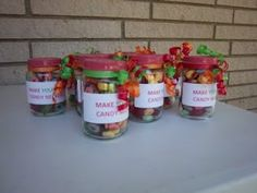 Found the idea in a Parents magazine and made it our own using baby food jars, spray paint, labels, curling ribbon, cheerios, fruit loops, gummy life savers, and twizzler ropes.  They are Make Your Own Candy Necklace kits!!!  These were made by the wonderful and talented Mema Debbie.  She spray painted the lids, printed the labels in the color of the party, and tied curling ribbon around the top.    You can do this with so many other items and colors! - on ponytailmomma.blogspot.ca
