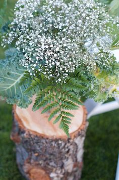 Kale, Baby's Breath, Fern Centerpieces | Wood Logs | Wedding Ceremony Aisle Decor