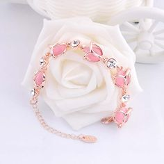 http://gemdivine.com/romantic-female-bracelet-jewelry-fashion-rose-flower-shaped-high-grade-opals-crystal-charm-bracelets-for-womangirls-best-gifts/