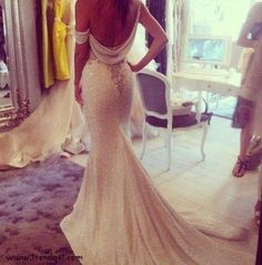 Low back fitted wedding dress with sparkle! This is such a beautiful dress!
