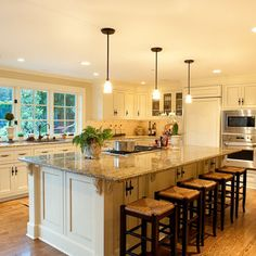 Island with cooktop, again oriented with cook's back to the sink. Nice furniture details with corbels.