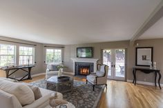 Living room with gas fireplace and French door access to private patio grounds