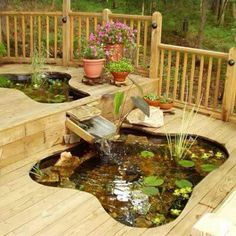 Inspiration for future back deck ... integrate recirculating water feature IN the deck... hmmm