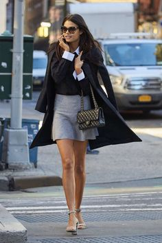 black/dark sweater with white button up and grey skirt