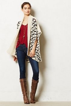 Swing sweater with great texture and pattern. Love it paired with the bright red top and boots.