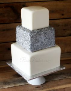 square wedding cake with flowers around the bottom - Google Search