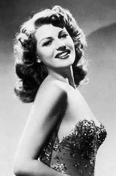 Rita Hayworth Halloween with red lipstick, net gloves, net hats, sparkly dress, little heels for shoes :)