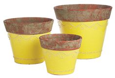Here, a trio of pots in a soft yellow hue with a beautifully aged patina and elegant details.