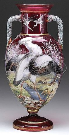 Moser Glass; Vase, Handled, Heron by Stream, Enamel Decoration, Cranberry, 20 inch.  A Moser glass monumental cranberry vase enameled with an intricate design of a heron by a stream. The enamel work was painstakingly created in realist... [more detail available via subscription]  p4A Item E8941363  Category: glass Origin: Czechoslovakia Type: moser  Year: 1895 - 1925
