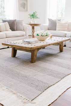 Coastal Farmhouse Living Room - Neutral Living Room - Sherwin Williams Alabaster - Layered Rugs - Slipcovered Sofa - Cream Couch - Modern Farmhouse - Interior Design - Large Light Fixture in Living Room Farm House Living Room, Farmhouse Rugs, Home Decor Trends, Layered Rugs, Coastal Living Rooms, Trending Decor, Farmhouse Rugs Living Room, Living Room Reveal, Rugs In Living Room